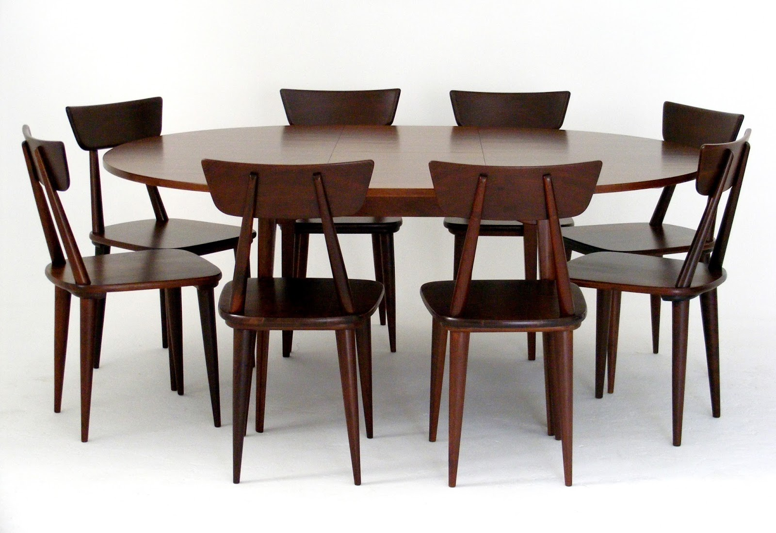 A Mid Century Extendable Dining Table Designed By EE Meyer For Binnehuis Using Combination Of Solid And Veneered Imbuia