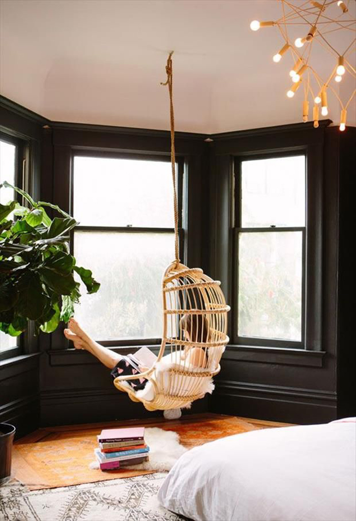 reading in hanging chair