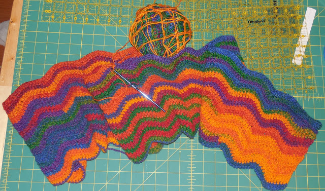 crochet ripple blanket in rainbow yarn