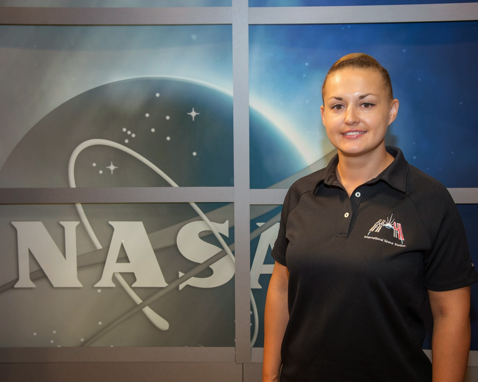 Russian cosmonaut Elena Serova, Expedition 41/42 flight engineer, poses for a portrait following an Expedition 41/42 preflight press conference at NASA's Johnson Space Center. Photo credit: NASA/Bill Stafford