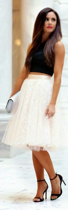 Black crop top, white tulle skirt, heels, clutch