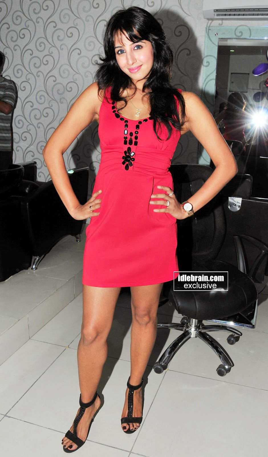 sanjana red short dress at event