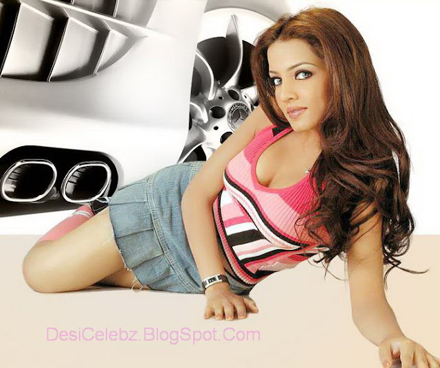 Hot Celina Jaitley photoshoot in pink top and sexy mini skirt