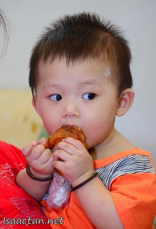 "Baby Martin ""enjoying"" his chicken drumstick"