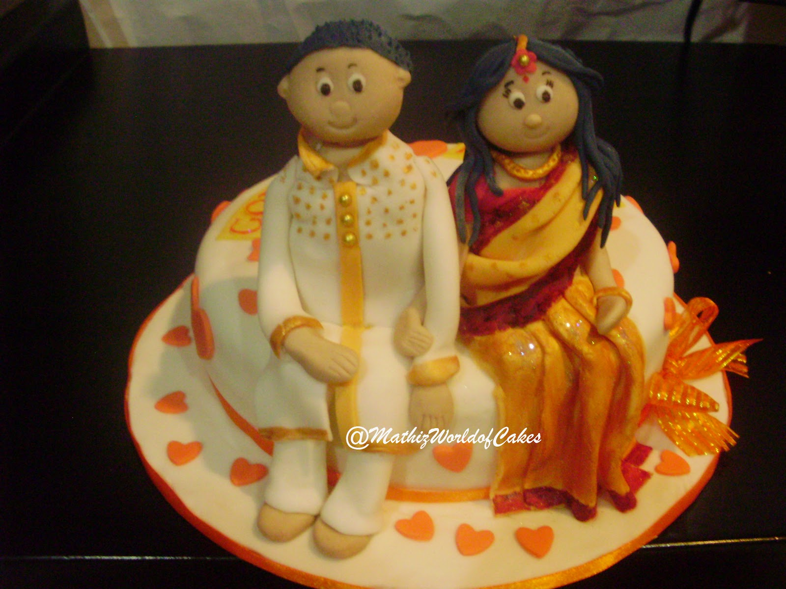 Mathiz: Engagement cake with indian couple fondant figurine