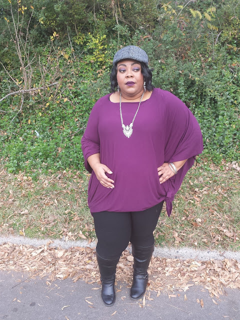 purple poncho with black skinny jeans and fashion hat