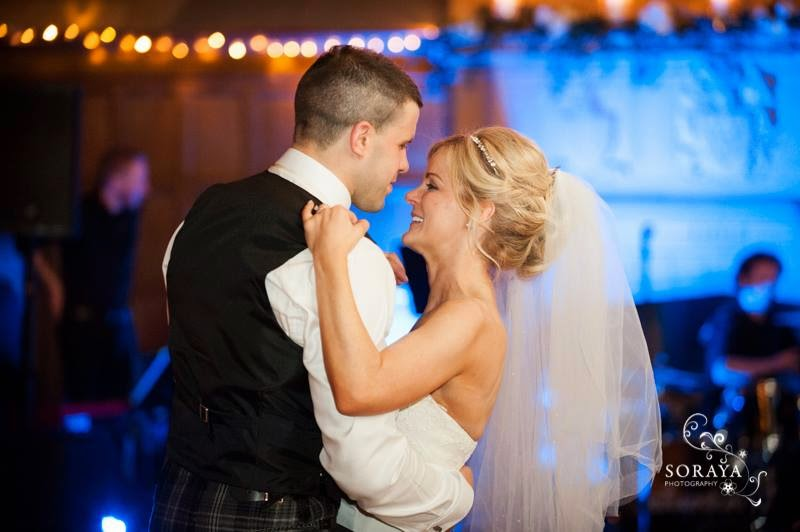 Bride and gromm have their first dance at their wedding in a stately home in the highlands of Scotland. Bride wears a flowing veil and soft waved hair