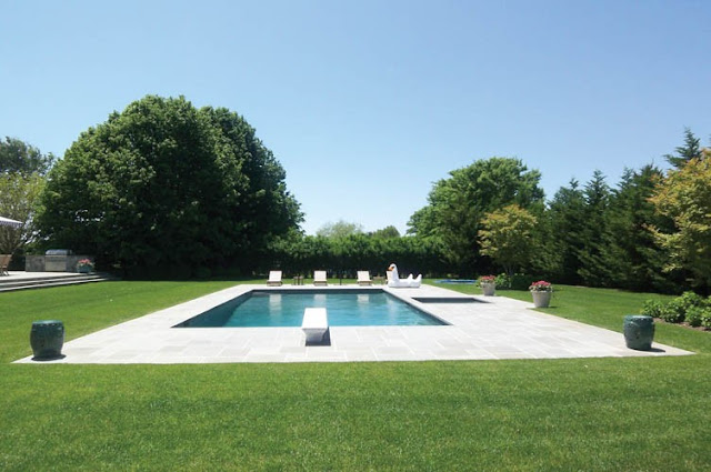 backyard and pool of a house in the Hamptons