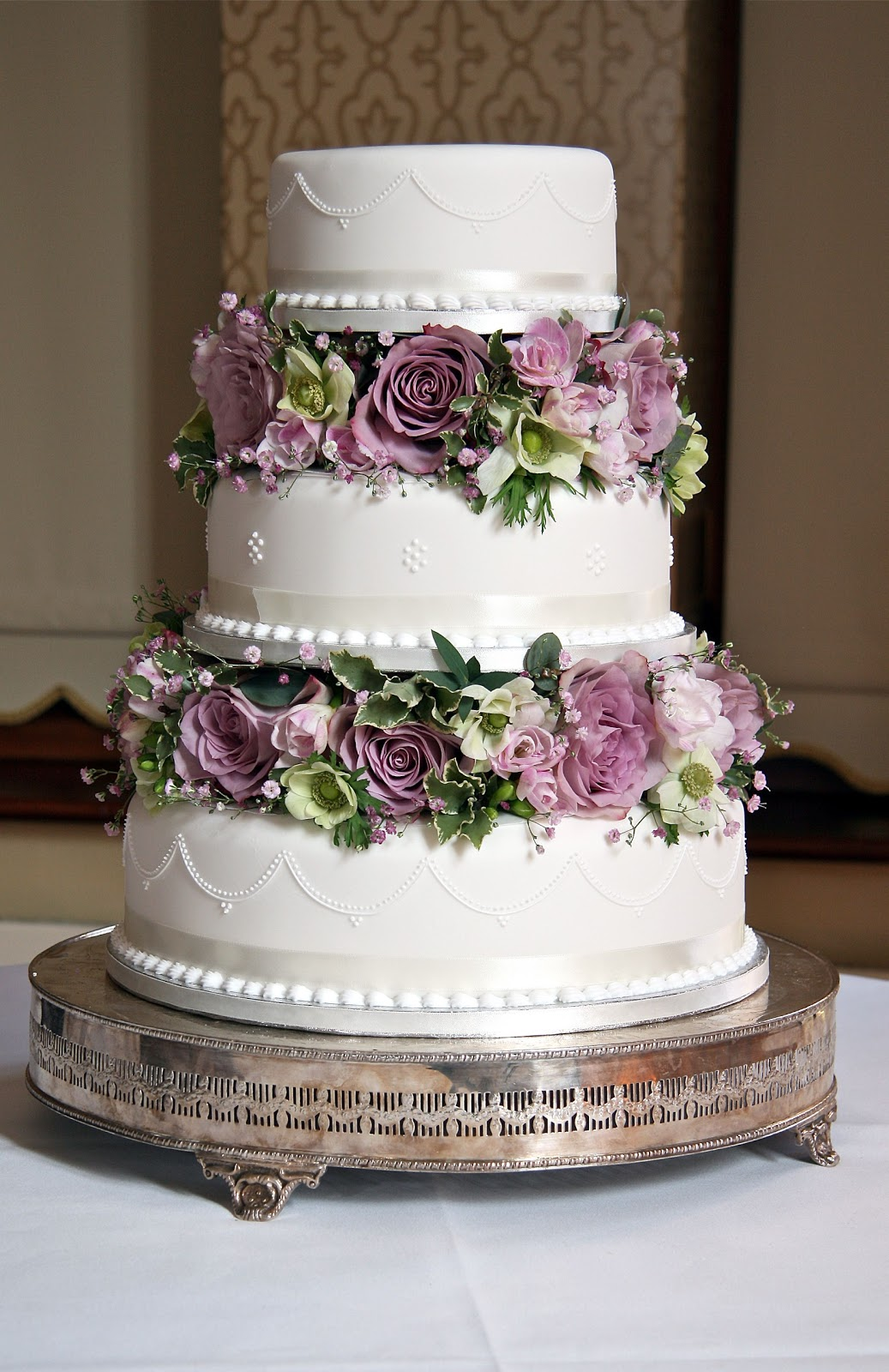 wedding cake with flowers in between the layers. I themed the flowers ...