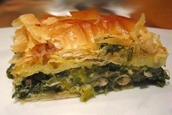 Spanakopita (Greek Spinach Phyllo Pastry Pie): A classic Greek vegetarian dish of wilted and chopped spinach greens mixed with onion, leek and Feta cheese in an egg base baked in a filo (phyllo) pasty shell and served just warm.