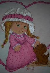 Boneca pintada em tecido