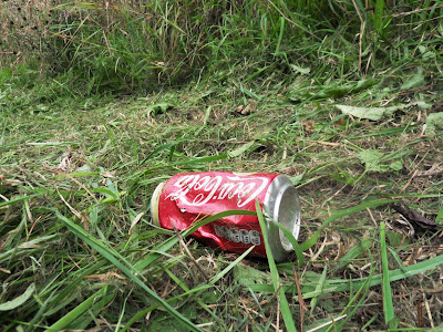 Coca-Cola tin on grass verge