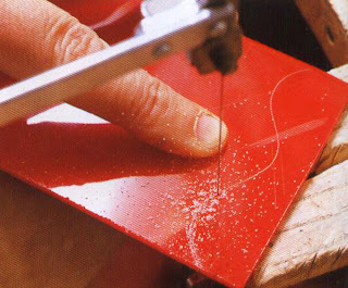 Use an ordinary jeweler's saw or a coping saw to cut sheets of plexiglass.