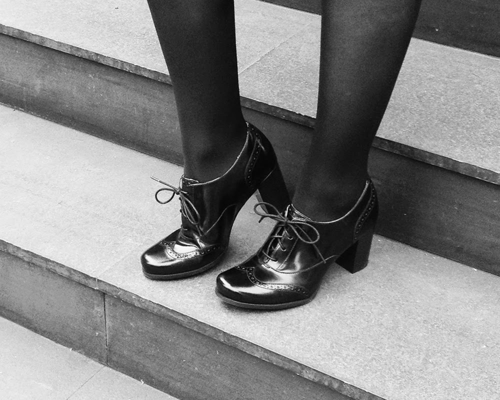 Black leather Clarks brogues