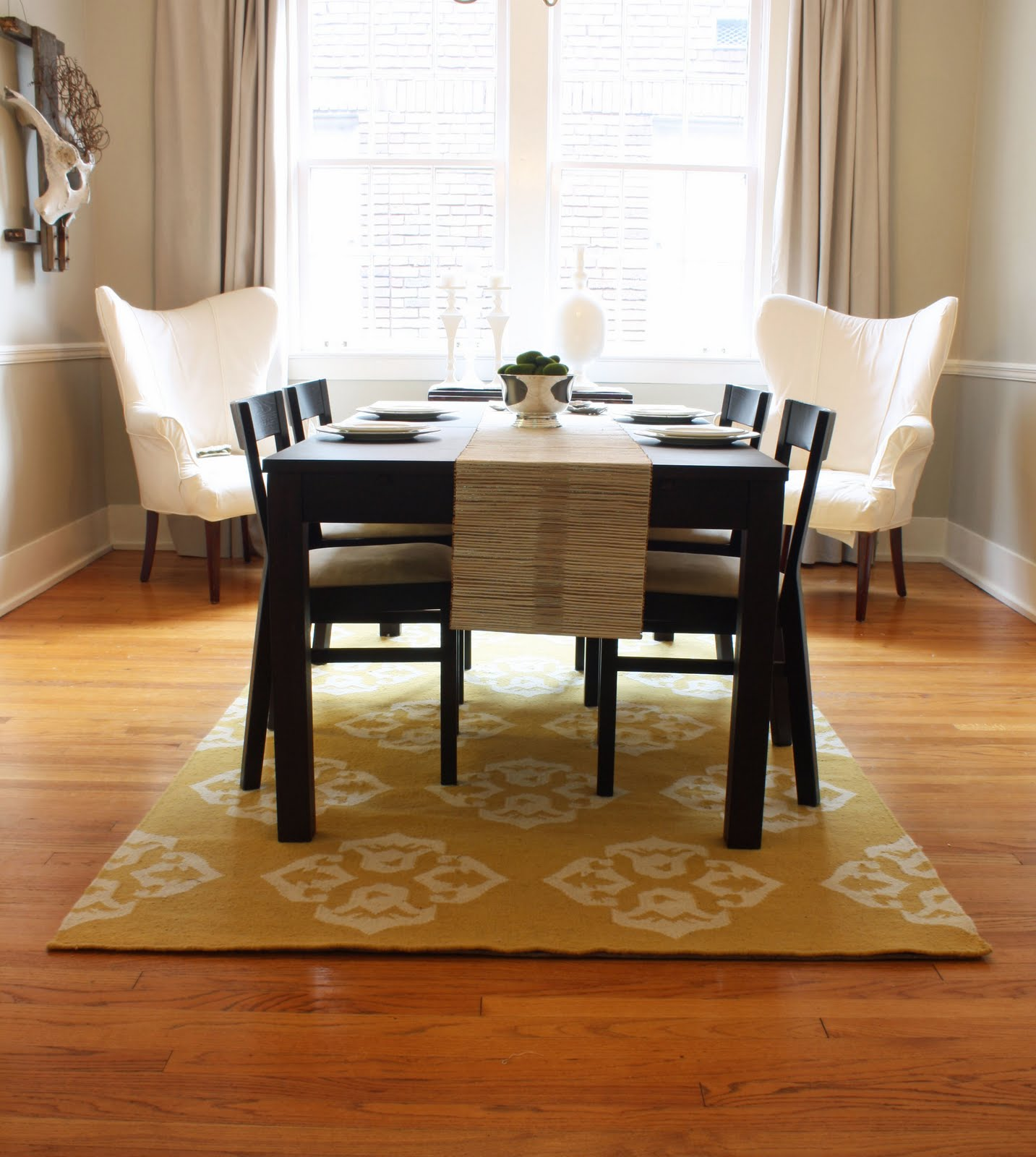 Dwell and tell dining room updates curtains rug for Dining room rug ideas