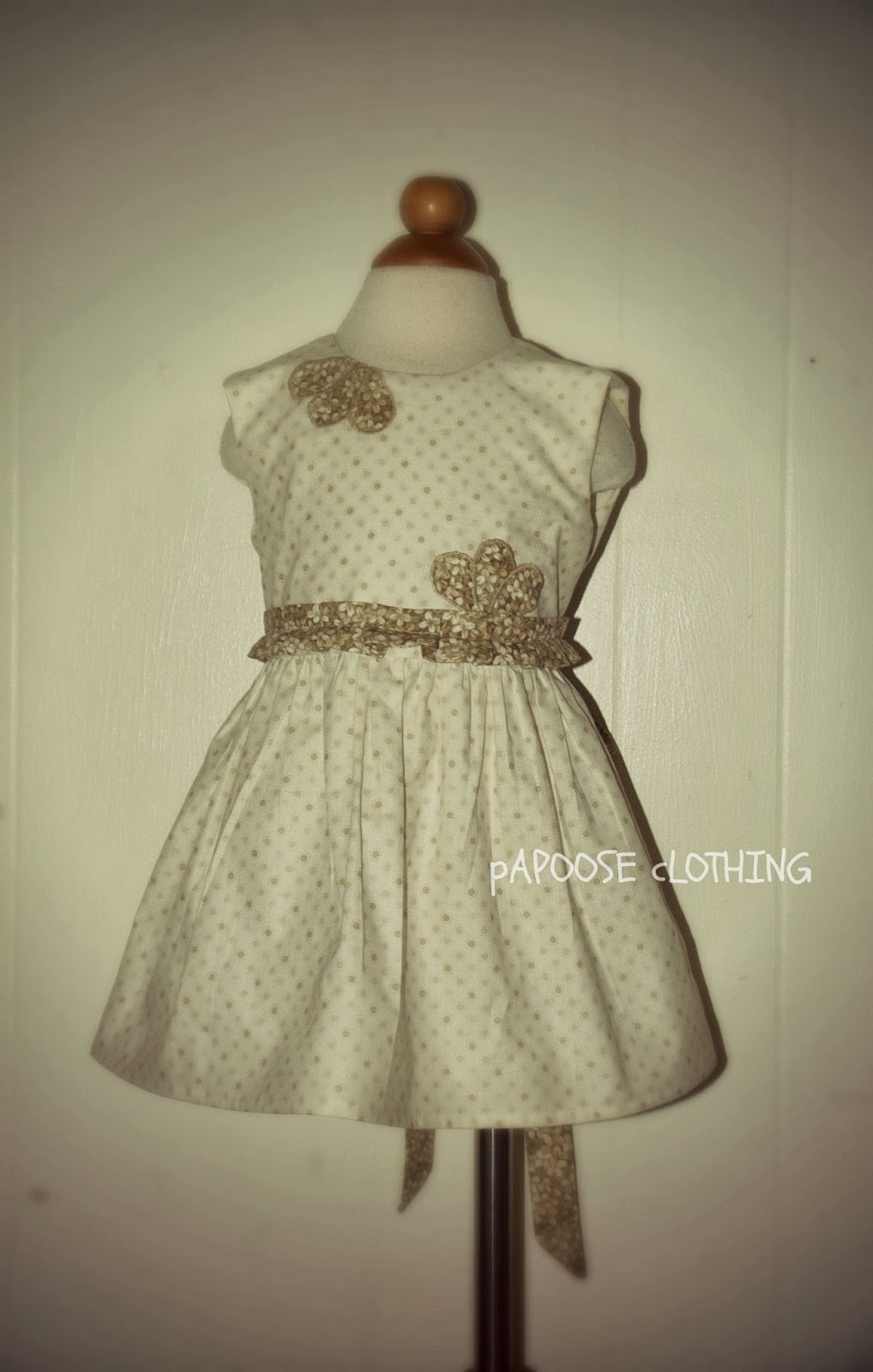 http://www.papooseclothing.com/store/p42/Natural_Sand_Polka_Dot_Magnolia_Dress.html