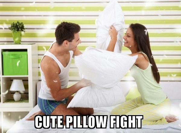 couple pillow fight