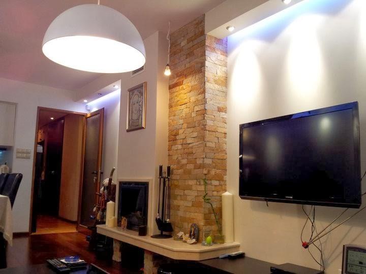 Всекидневна с вградена камина и скрито осветление 2