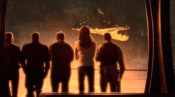 "Chloe, Young, Rush, and others watch the shuttle leave the Destiny in Stargate Universe's ""Light"""