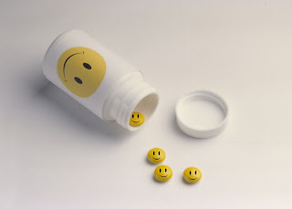 happy pills Swallowing a Big Pill.........