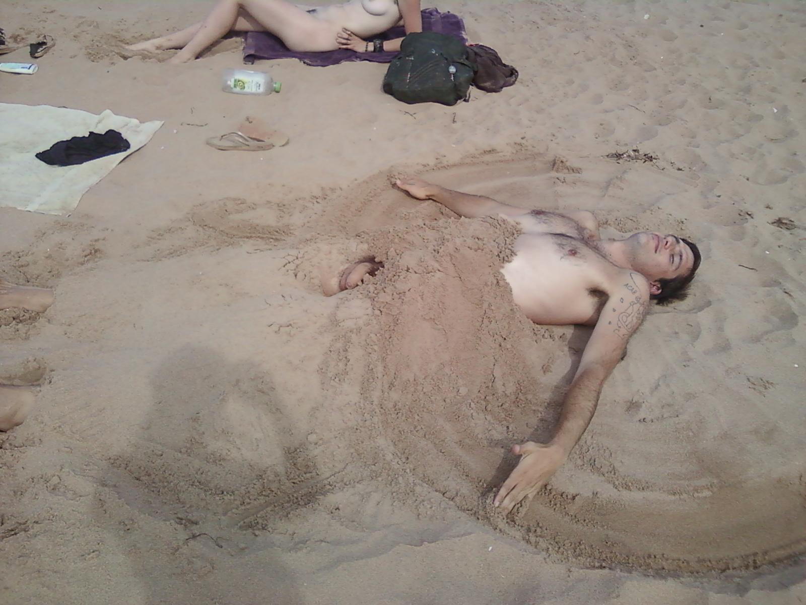 Beach on Nude buried girl