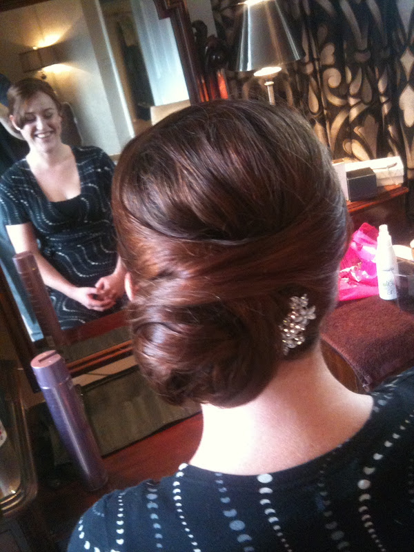The other bridesmaid went for a side bun hairstyle which looked ultra  title=
