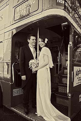bride and groom posing on Routemaster bus