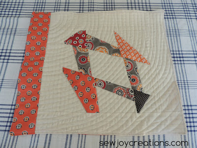 Liberated Churn Dash placemat with curve quilting