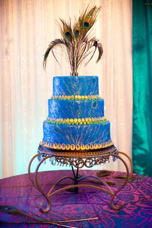 Amazing round three tier royal blue peacock wedding cake with peacock