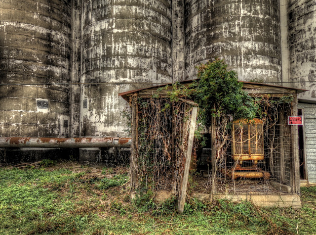 HDR (high dynamic range) photo of a machinery shed in front of a disused silo complex in Katy, Texas. - HDR
