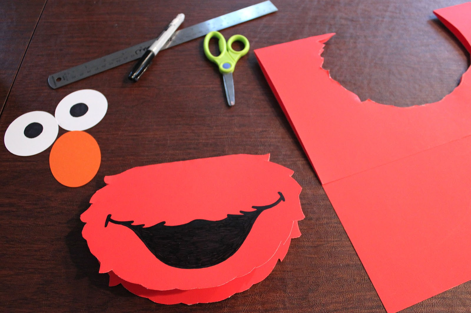 Cut out 2.5 inch circles for the eyes with the white card stock and a