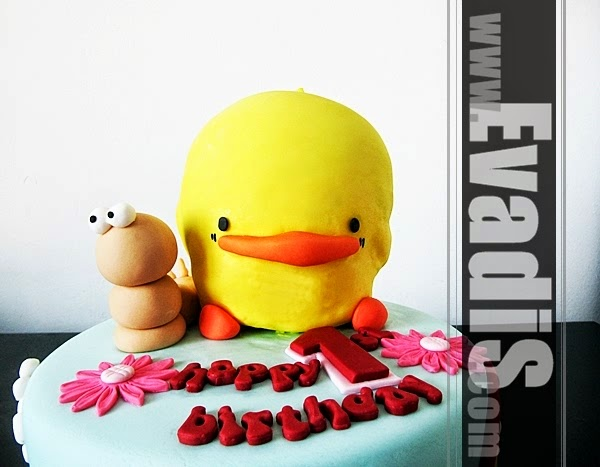 Picture of duckie and caterpillar on cake