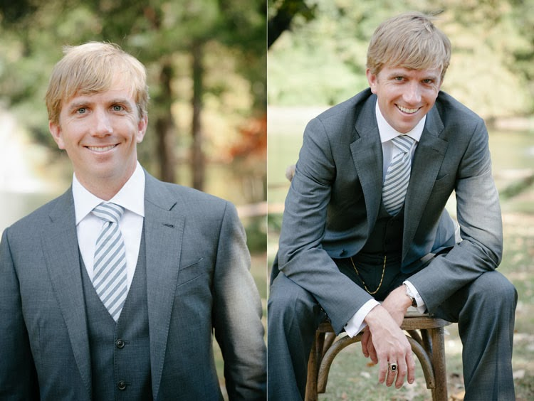 groom smiling for portraits in his armani suit and billy reid tie