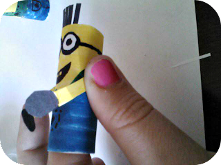 putting arms on a minion finger puppet