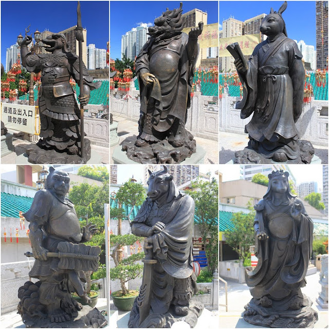 Some of 12 Chinese Zodiac statues display outside Wong Tai Sin Temple in Kowloon, Hong Kong