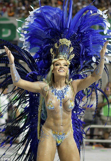 Dazzle: revellers from the Academicos do Tatuape samba school and the samba school Mancha Verde Special Group join in the first night of carnival parade at Sao Paolo's Sambadrome.
