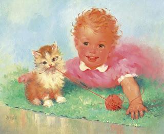 bebe jugando con gato