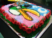 Green angry bird chocolate cake with butter cream frosting