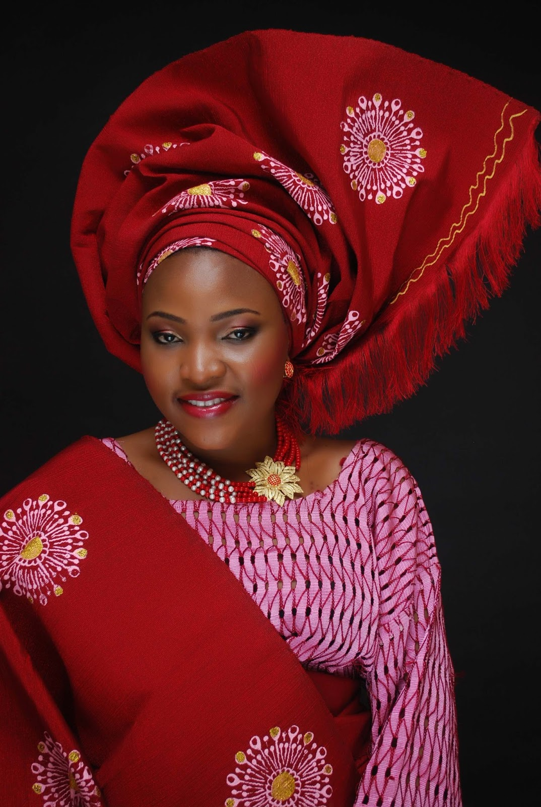 See + pictures of latest aso-oke designs, colours and styles – as seen on stylish brides at top Nigerian weddings. You will gorgeous men and women wearing assorted exotic aso-oke fabrics – silk aso oke, lace aso oke and more.