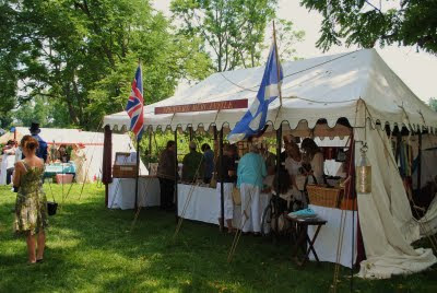 white tent at the jane austen festival at locust grove with a british flag fluing and people shoping