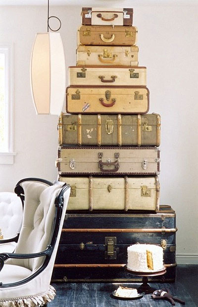 This stack of vintage suitcases adds a vintage flare to the bedroom.