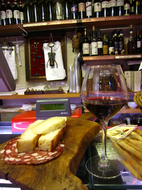A photo of red wine, cheese and salami in Siena, Italy.