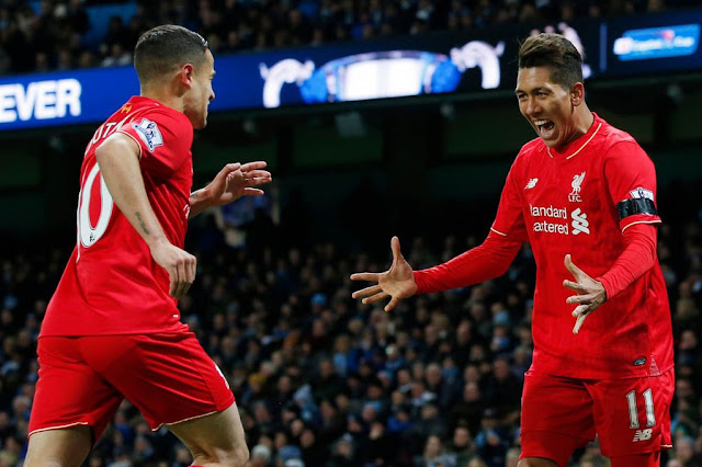 Roberto Firmino celebrates with Philippe Coutinho after Eliaquim Mangala scored