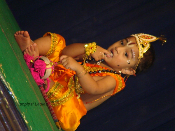 Baby Lord Krishna licking butter