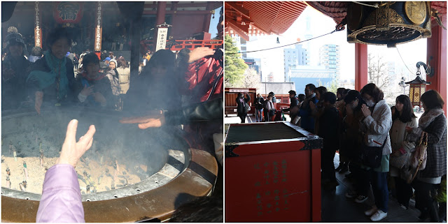 Fan some smoke towards yourself as the smoke is believed to have healing power and throw a coin into the offering box, clap your hands twice and pray for a few seconds at Asakusa Sensoji Temple in Tokyo, Japan