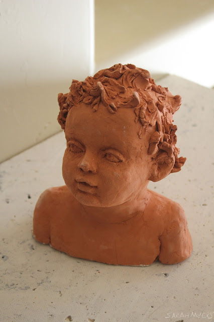 child, baby, sculpture, art, sarah myers, sarah, myers, head, infant, portrait, escultura, ceramica, arte, niño, earthenware, ceramic, terracotta, amy myers, eyes, glance, face, small, young, realistic, figurative, classic, classical, human, endearing, beautiful, darling, expectant, new, work, artwork, bust, red, upward, artist, mother