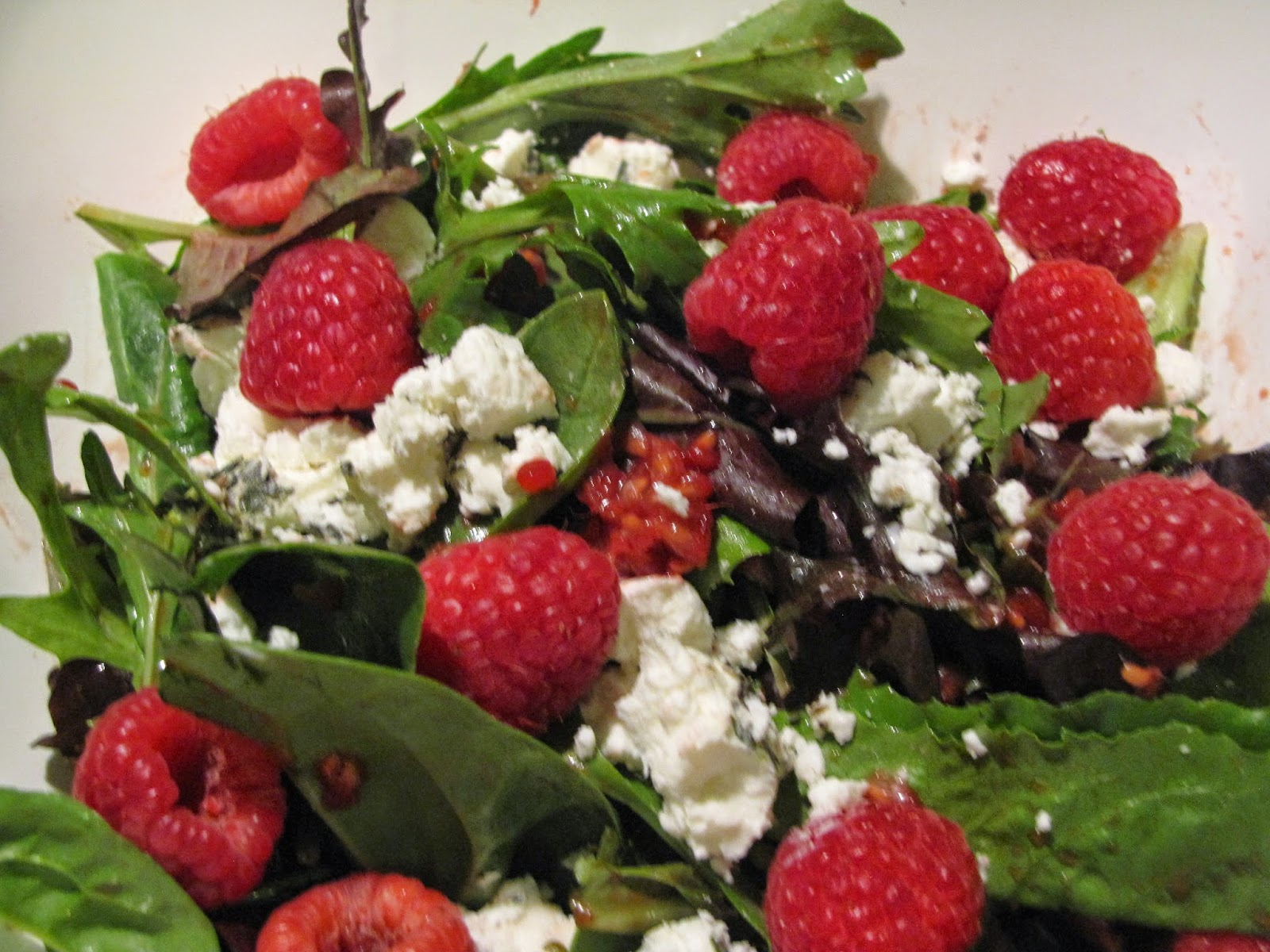 Spring Mix Green tossed with a raspberry pomegranate dressing and topped with herbed goat cheese