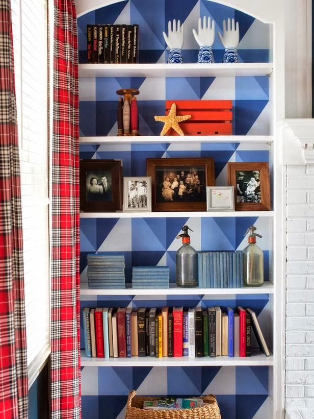 geometric wallpaper on back of bookcase