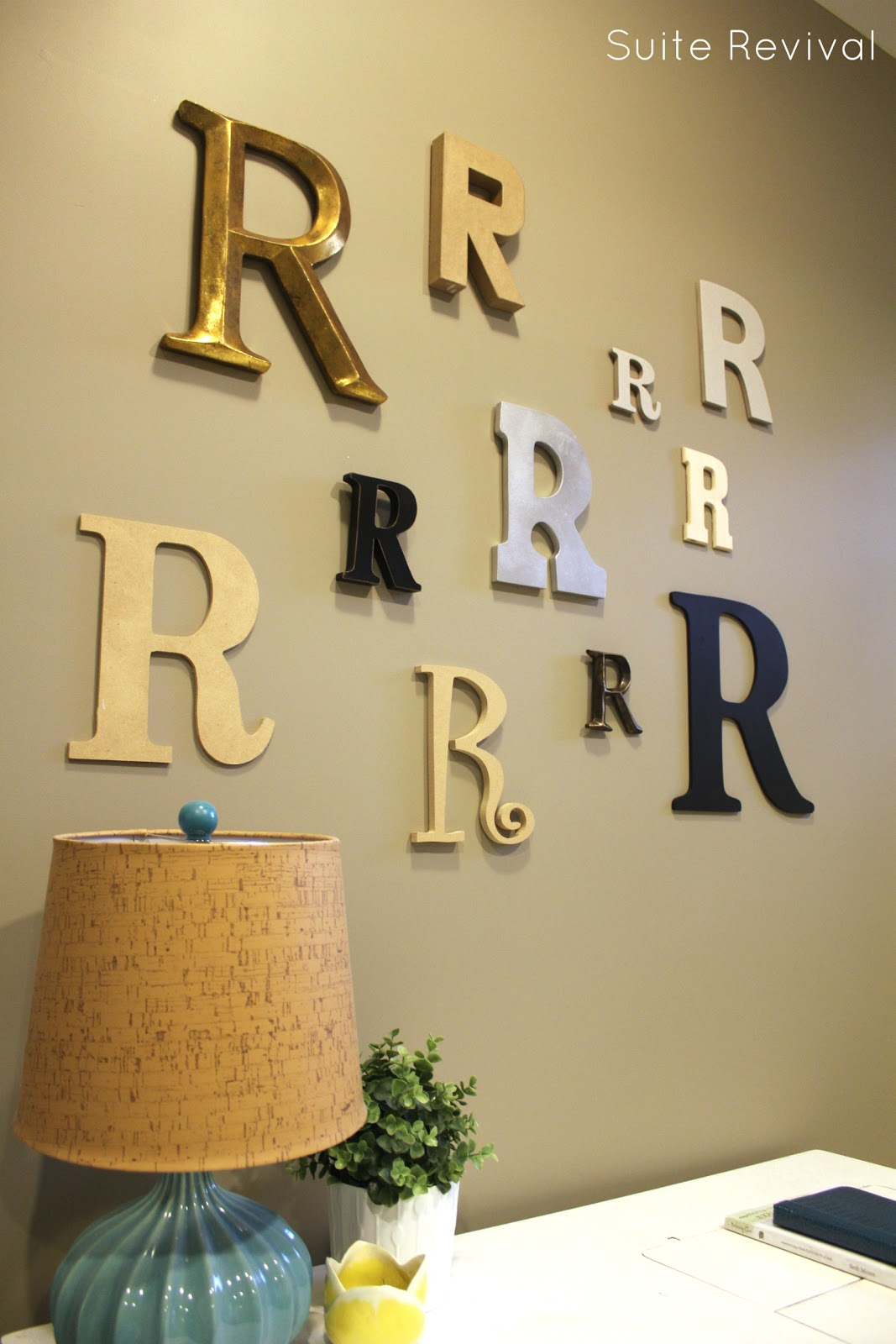 a letter wall since my name is rachel i obviously gravitated toward the letter r i laid all the letters out on the floor trying to figure out the best