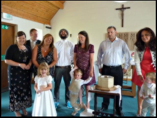 Godparents at children's christening